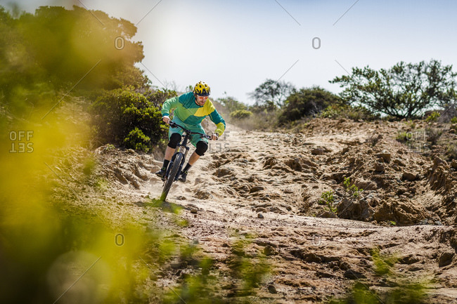 Man riding mountain bike on dirt track- Fort Ord National Monument Park- Monterey- California- USA