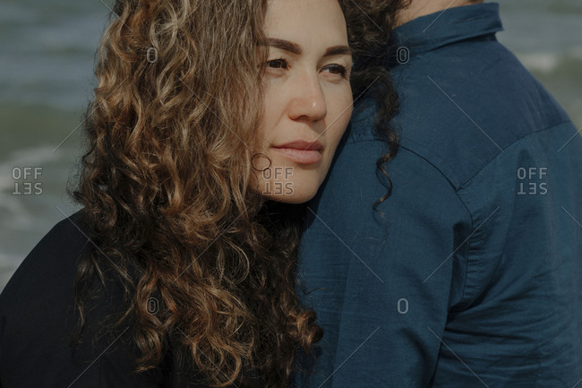 Portrait of woman leaning on her husband's shoulder