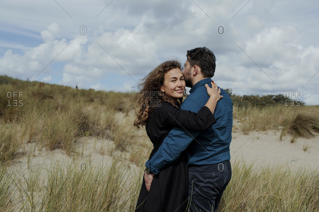 Portrait of woman hugging her husband in the dunes- The Hague- Netherlands