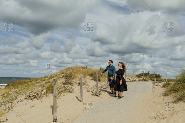 Family with two little children walking to the beach- The Hague- Netherlands