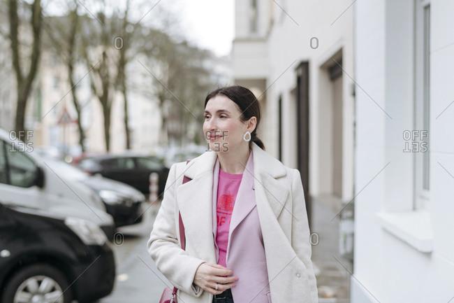 Portrait of stylish woman in white coat