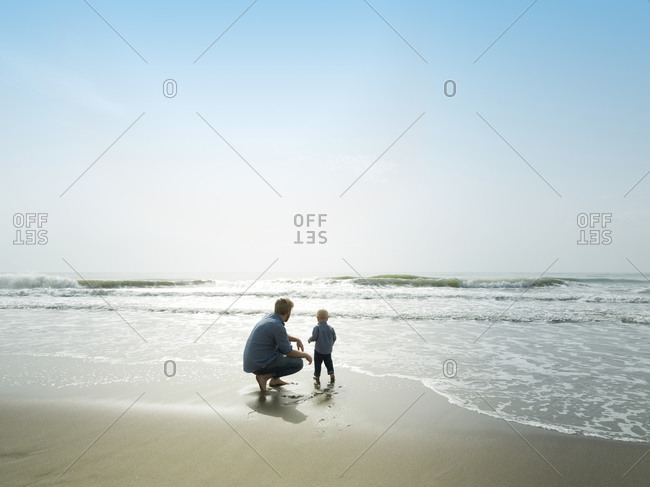 Father and son on a beach day, Bajondillo Beach in Torremolinos,