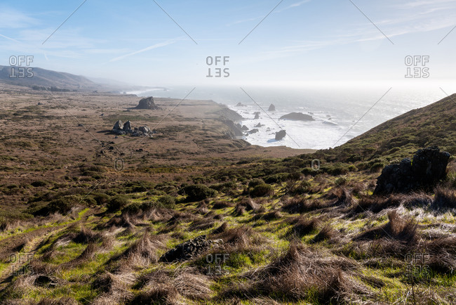 Sweeping view of headlands and ocean from top of hill