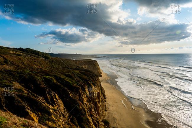 Coastal Headlands looking down where ocean meets the beach