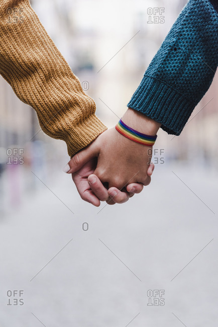 Hands Of Lesbian Couple. LGBT Concept.
