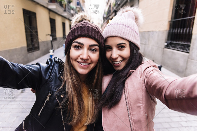 Beautiful Lesbian Couple Taking A Self Portrait At The Street