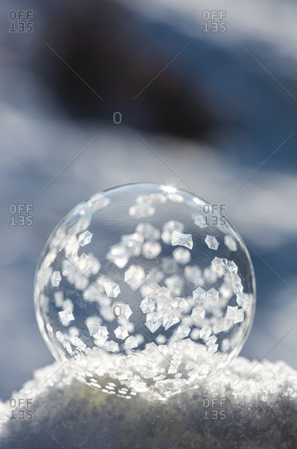 Close up image of soap bubble freezing in the snow on a winter's day.