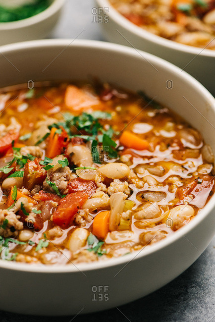 Italian sausage and white bean soup closeup