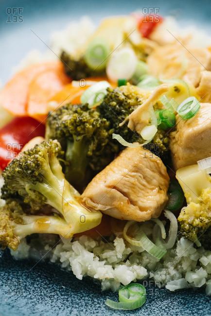 Paleo sweet and sour chicken over cauliflower rice closeup detail