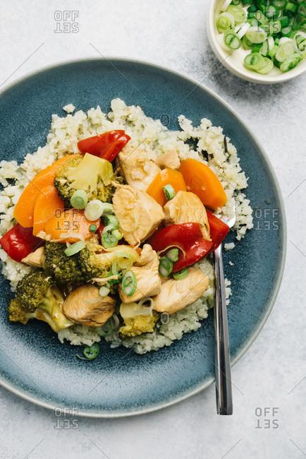 Paleo sweet and sour chicken over cauliflower rice