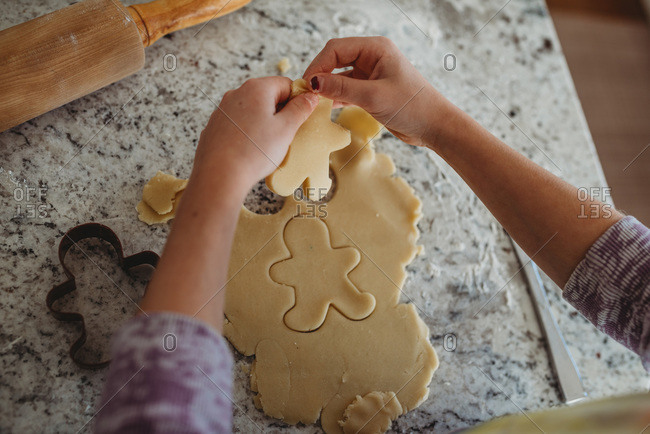 Overhead of girl with gingerbread cookie cutout