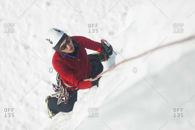 Woman climbs at ice park in Lake City, Colorado