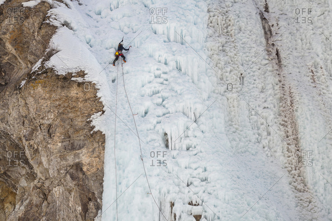 Woman climbs cliff at ice park in Lake City, Colorado