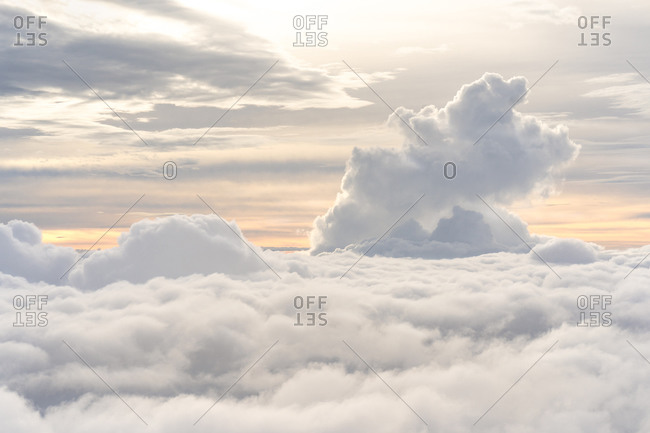 Beautiful view from above clouds at dusk