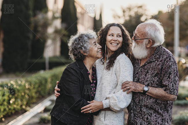 Lifestyle portrait of active senior married couple and adult daughter