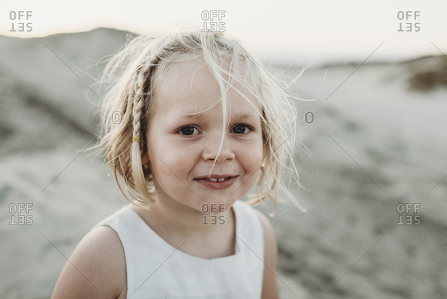 Portrait of preschool-aged girl smiling at beach
