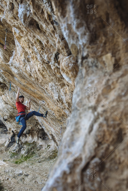 Climber beginning a hard route in a sport climbing cave.