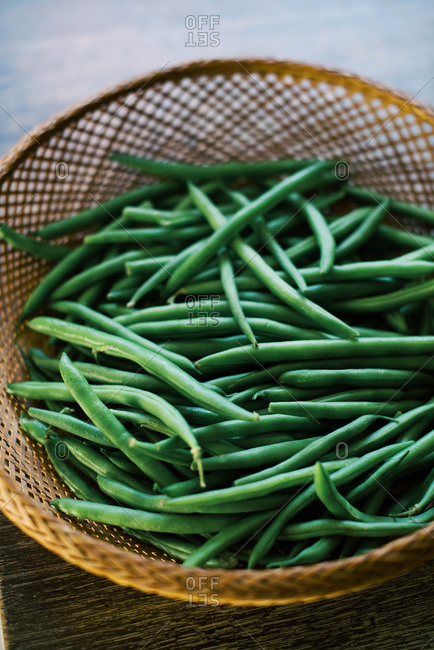 Close up of fresh green beans in a basket