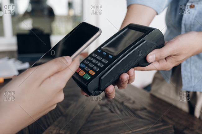 Paying bill through smartphone using NFC technology.