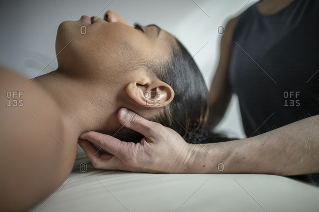 Close up of African American female receiving neck massage