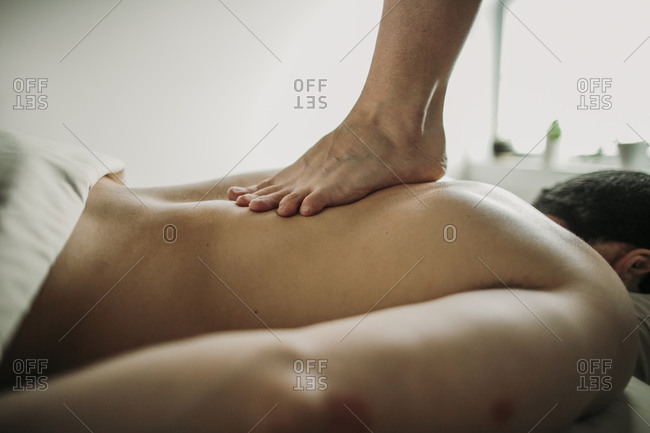 Massage therapist uses the ashiatsu technique to treat her patient