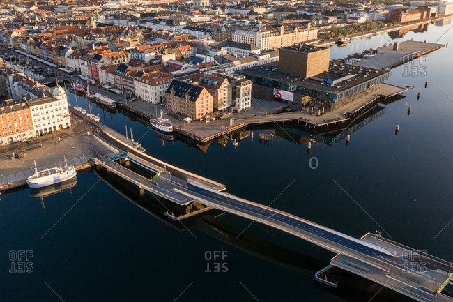 Copenhagen, Denmark - April 21, 2019: Aerial view over Inderhavnsbroen (the Inner Harbour Bridge) pedestrian and bicyclist bridge joining Nyhavn and Christianshavn