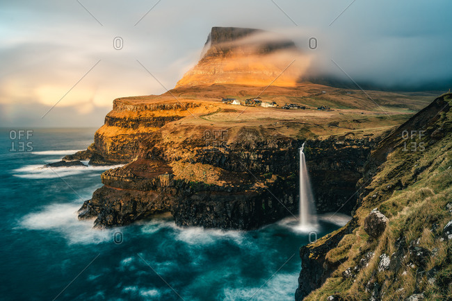Golden hour at the Mulafossur Waterfall at Gasadalur in the Faroe Islands