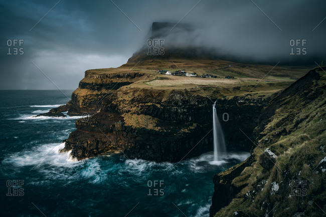 Stormy sky over the Mulafossur Waterfall at Gasadalur in the Faroe Islands