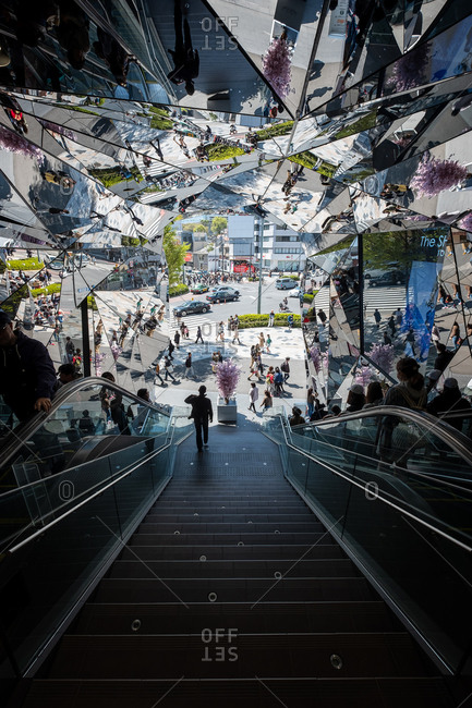 Tokyo, Japan - March 30, 2018: Reflections in the mirrored entranceway in Tokyu Plaza Omotesando located in the Harajuku district