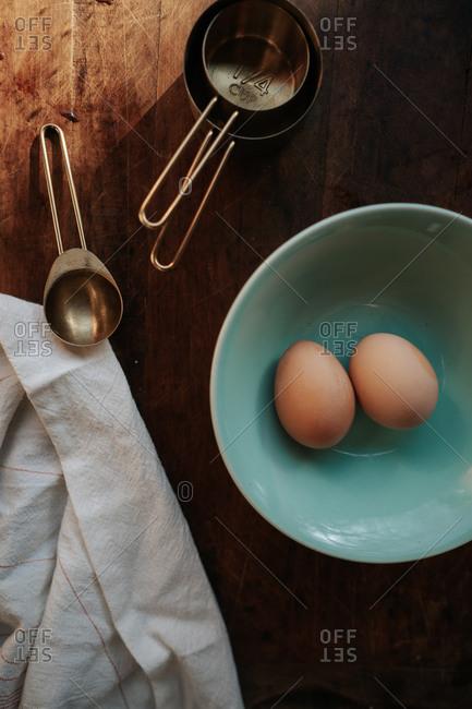 Brown eggs in spring blue bowl