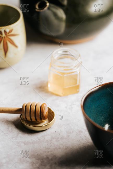 Overhead of honey and tea on a light table