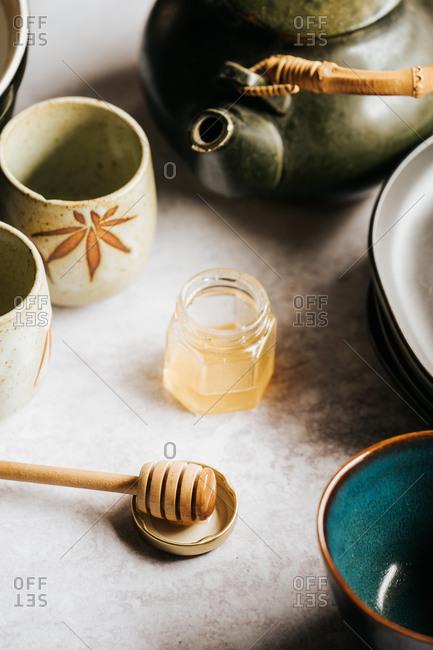 Fresh honey and tea on a light table