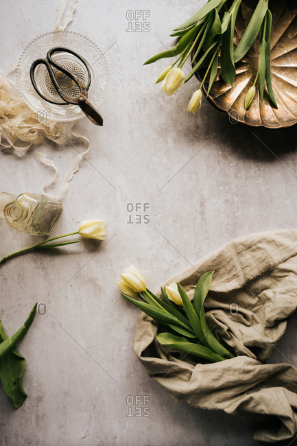 Fresh spring tulips on light background with vintage dish