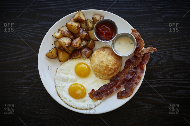 Bacon, eggs, potatoes and a biscuit for brunch with cocktail from above