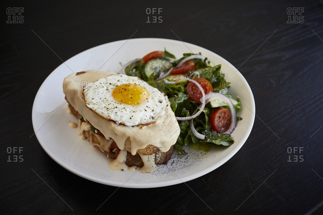 Brunch sandwich with fried egg and salad