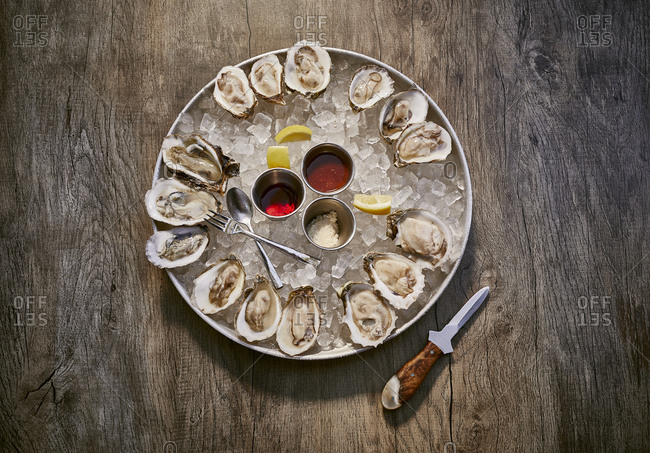 Oyster appetizer on a rustic wooden surface from above