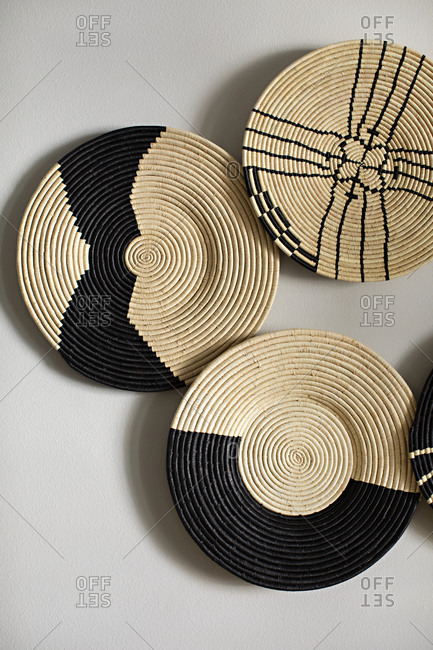 Decorative wicker plates on white surface