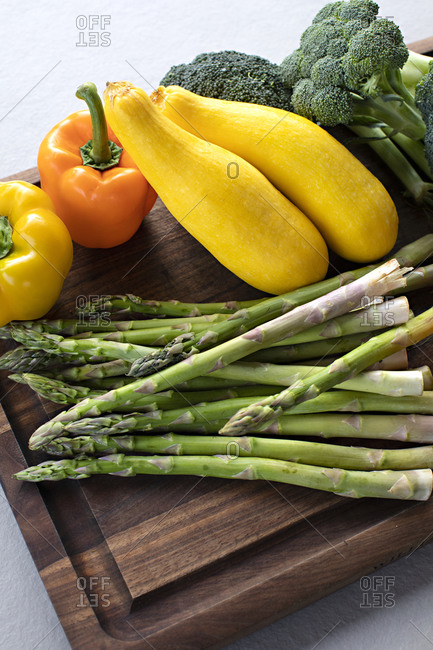Variety of fresh vegetables on a cutting board