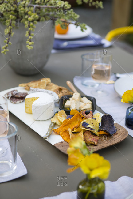 Cheese and meat appetizer on an outdoor table