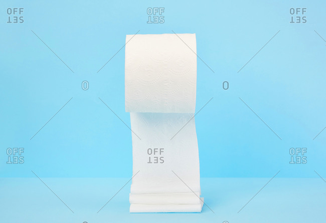 Toilet paper on blue background