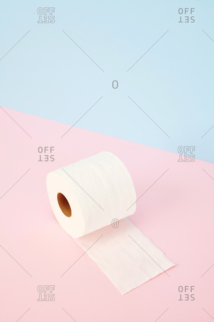 Toilet paper on pink and blue  background