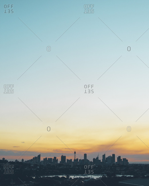 Distants skyline of a city during sunset