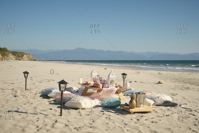Place setting on dining table at beach against clear blue sky during sunny day- Nayarit- Mexico