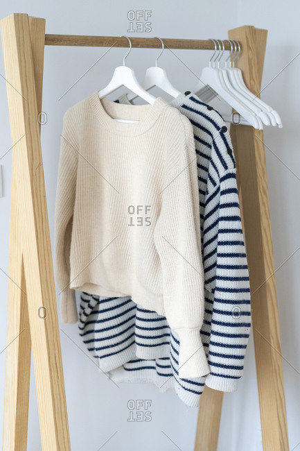 Pullovers hanging on clothes rack