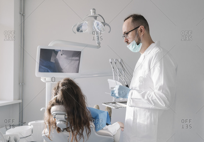 Young woman getting dental treatment in clinic
