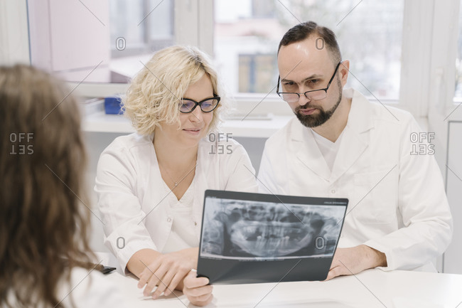Dentists talking about x-ray results to the patient
