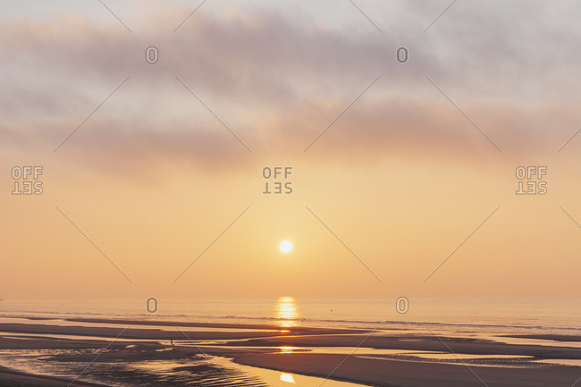 Scenic view of orange sky over sea during sunset- North Sea Coast- Flanders- Belgium