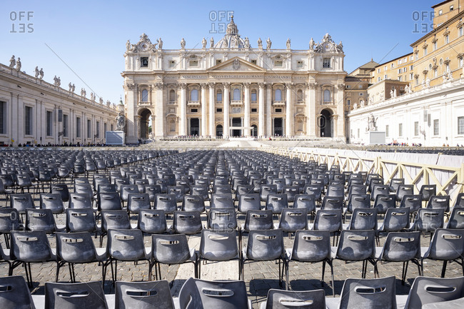 Italy- Rome- Rows of empty chairs in front of Saint Peters Basilica