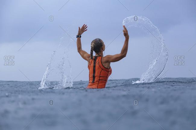 Female surfer at rain time- Sumbawa- Indonesia