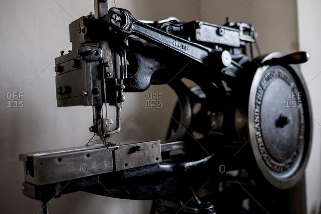 Close up of saddlery sewing machine in a saddler's workshop.